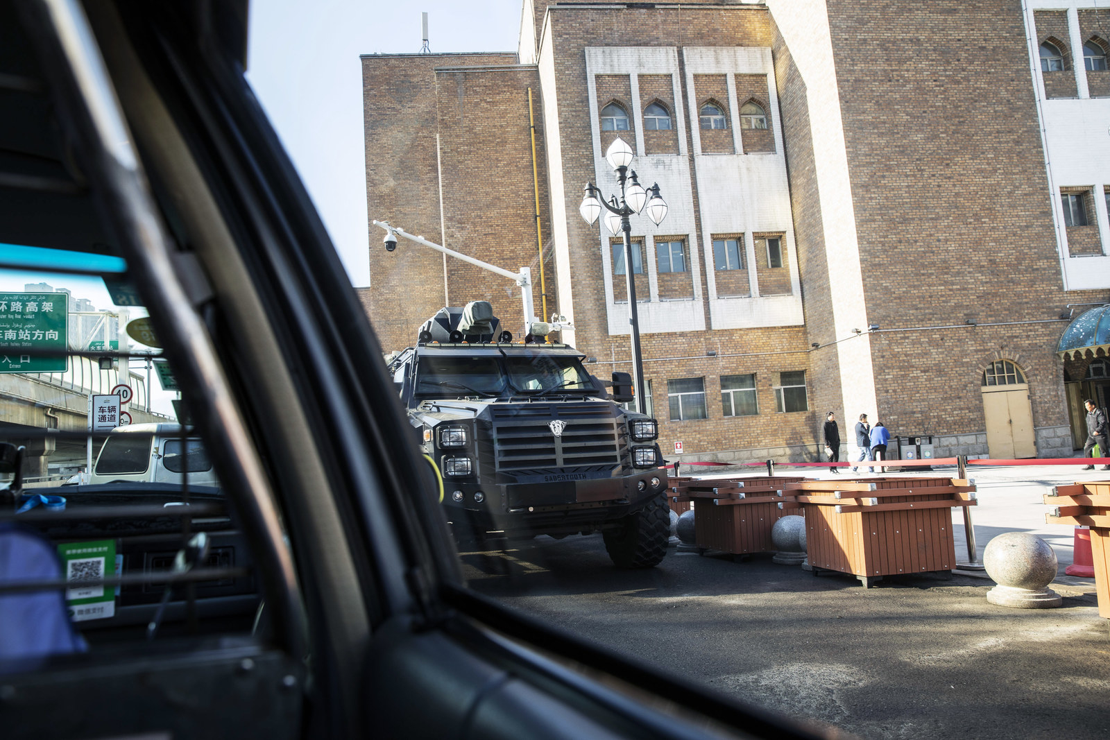 An armored police vehicle is seen from inside a taxi in Ürümqi, Xinjiang autonomous region, China, on Nov. 6, 2018.