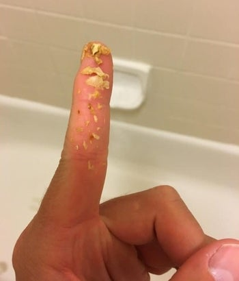 A reviewer photo of earwax on a finger