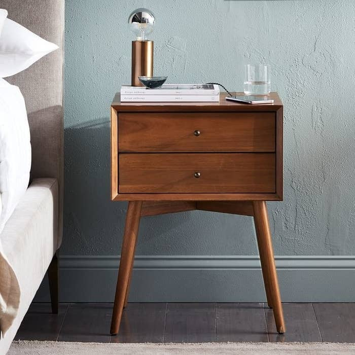 """""""I've had this bedside table for four years now, and I still love it. Because my studio apartment is truly *tiny*, these days it serves both as my bedside table and a side table to my couch. It's beautiful and the two drawers are surprisingly roomy!"""" —Natalie BrownGet it from West Elm for $299."""