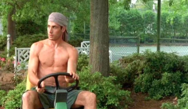 Freddie Prinze Jr. driving a lawnmower shirtless