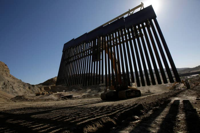 Heavy machinery moves a bollard-type wall, to be placed along the border of private property using funds raised from a GoFundMe account, at Sunland Park, New Mexico.