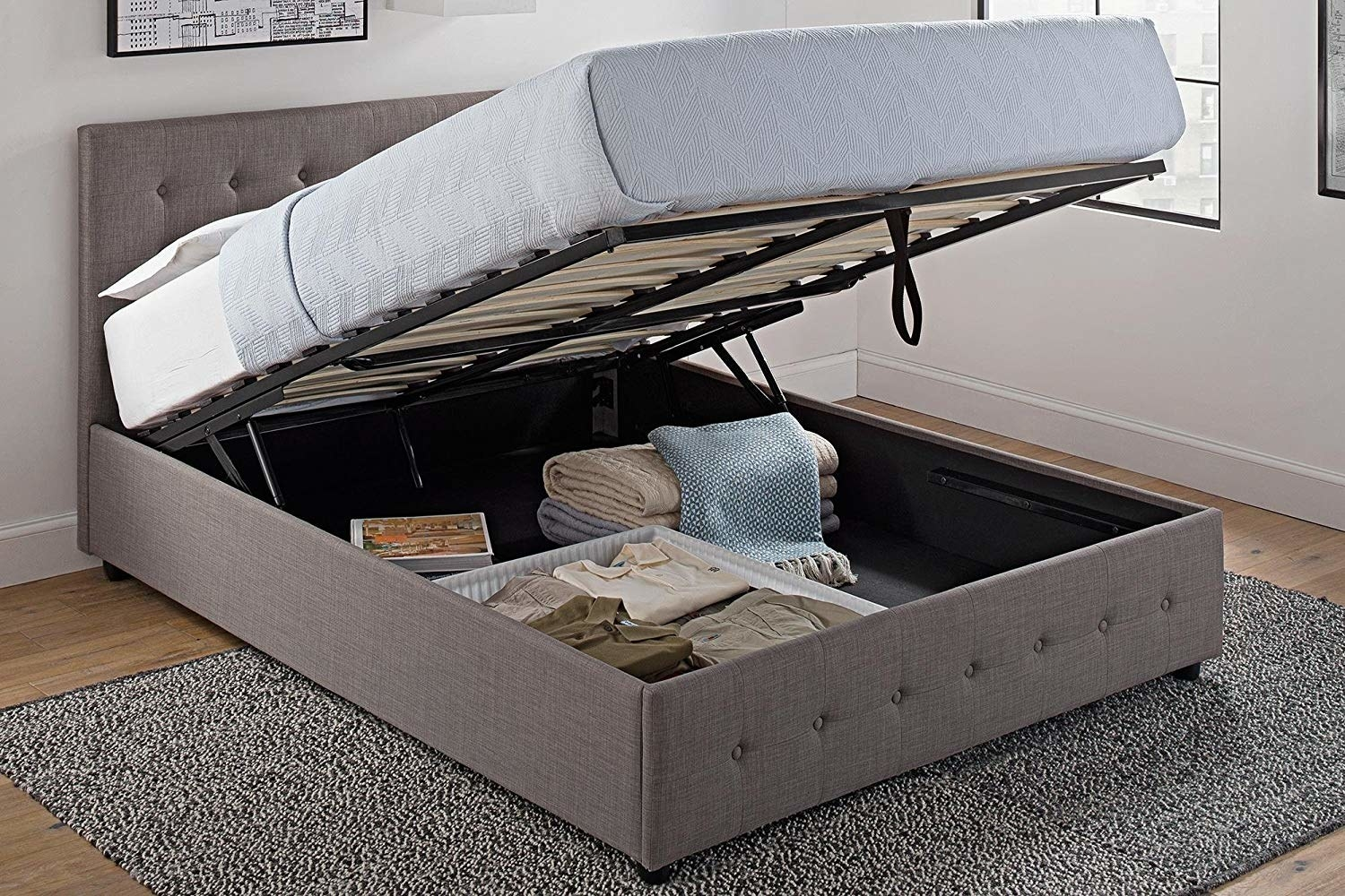 The bed with the mattress lifted up to show the under-bed storage