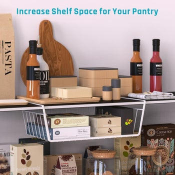 The slide-on white wire basket on a pantry shelf