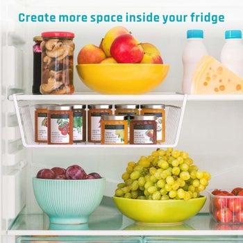 The same basket on a fridge shelf holding jars