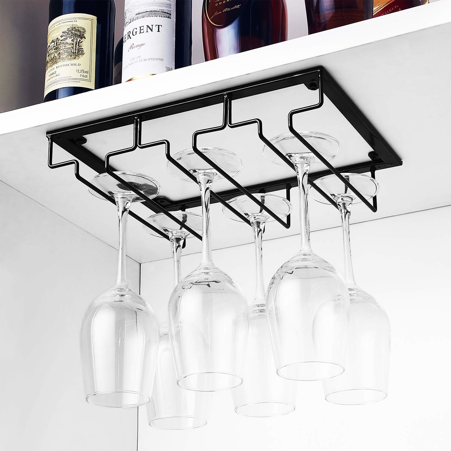Six glasses hanging from the black rack under a cabinet