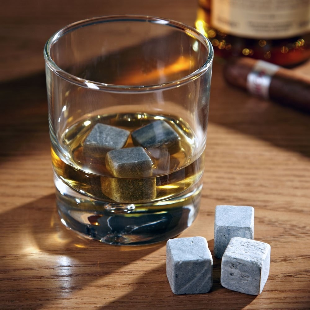 The grey whiskey stones in a glass of whiskey