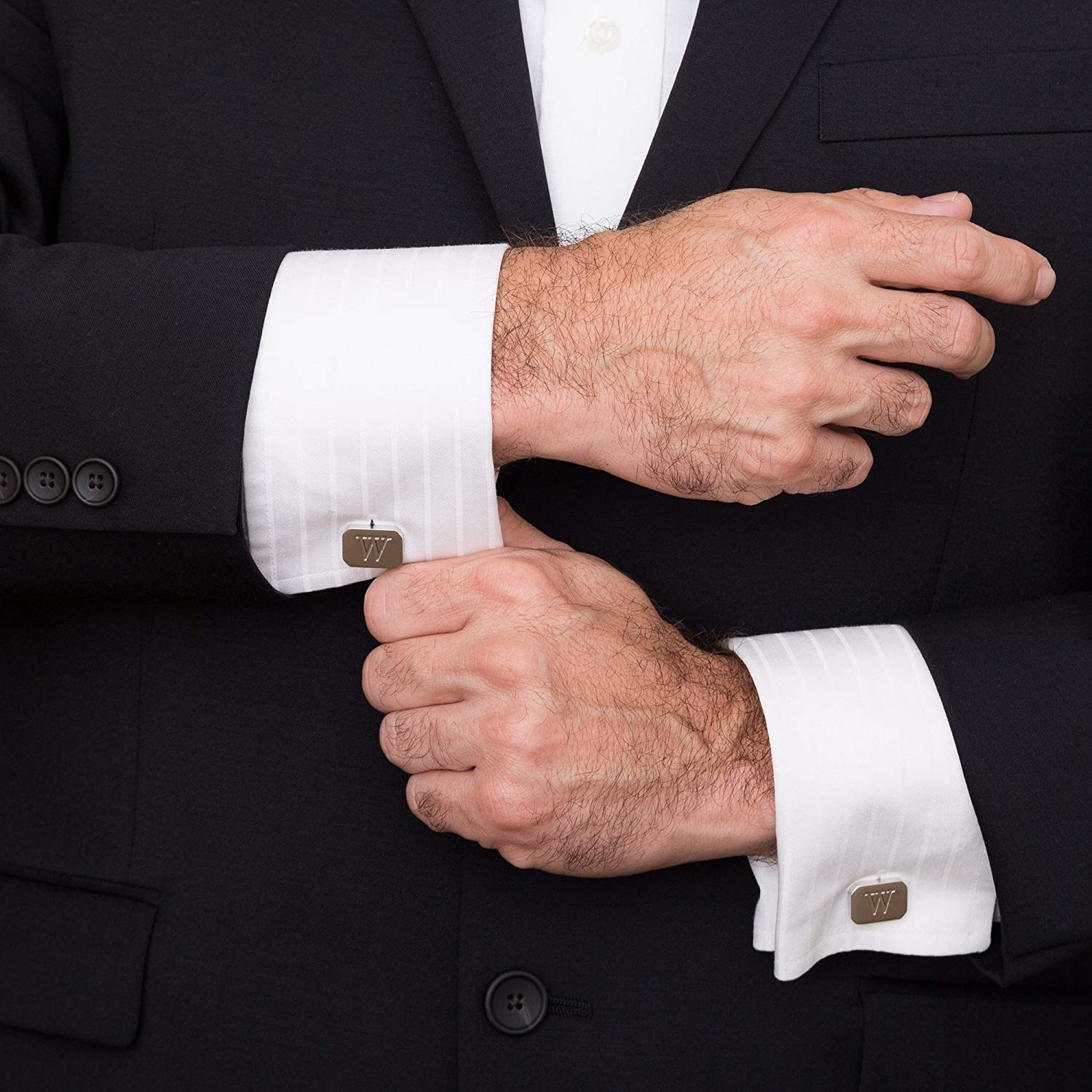 Model wearing the silver cufflinks