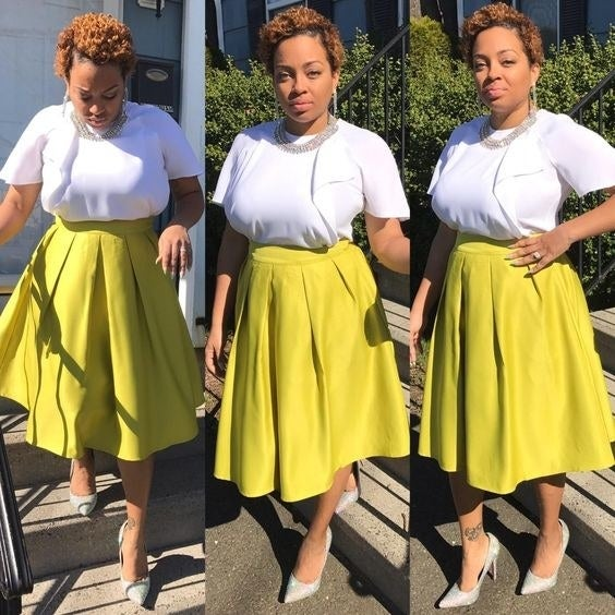 Reviewer in yellow high-waisted skirt