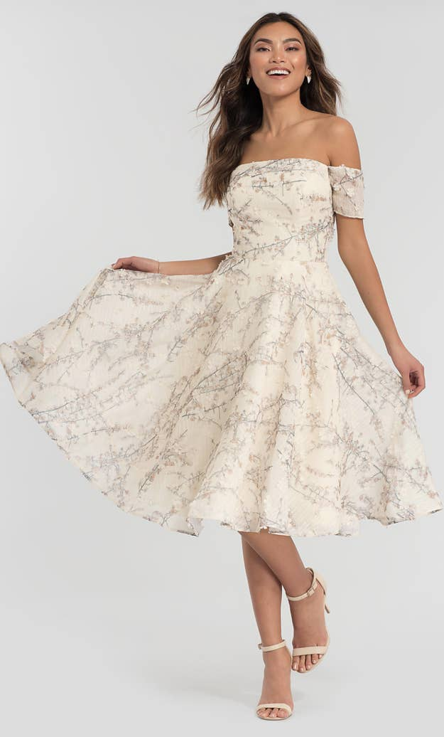 1e283465d83b4 Does this floral print tea-length stunner match your wedding aesthetic?