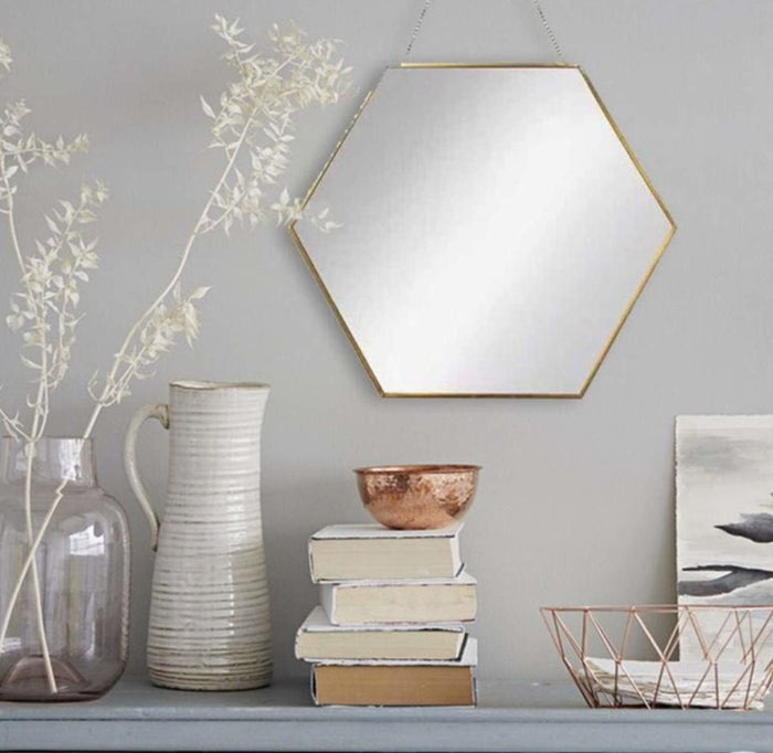 """Promising review: """"I was looking for a new mirror for my room, and I found myself purchasing the larger sized mirror. It came in a box, and was really secure and well packaged. It was super easy to put up on my wall, and it looks really nice over my desk!"""" —RaziaPrice: $27.99+ (available in two sizes)"""