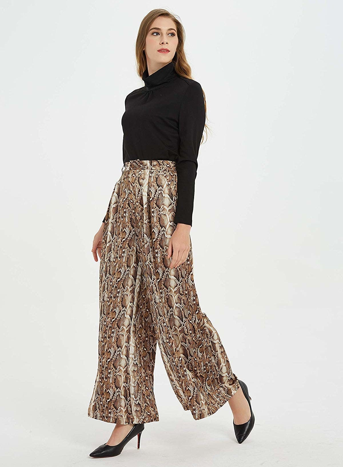 Model in the high-waisted palazzo pants in snakeskin