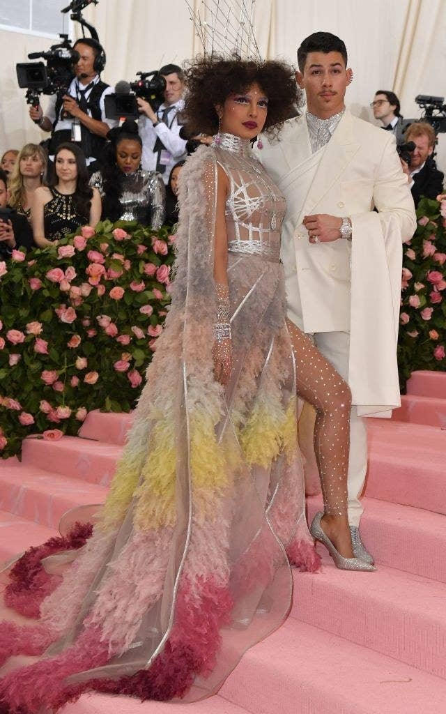 """Indian actress Priyanka Chopra and US singer Nick Jonas arrive for the 2019 Met Gala at the Metropolitan Museum of Art on May 6, 2019, in New York. - The Gala raises money for the Metropolitan Museum of Arts Costume Institute. The Gala's 2019 theme is Camp: Notes on Fashion"""" inspired by Susan Sontag's 1964 essay """"Notes on Camp"""". (Photo by ANGELA WEISS / AFP) (Photo credit should read ANGELA WEISS/AFP/Getty Images)"""