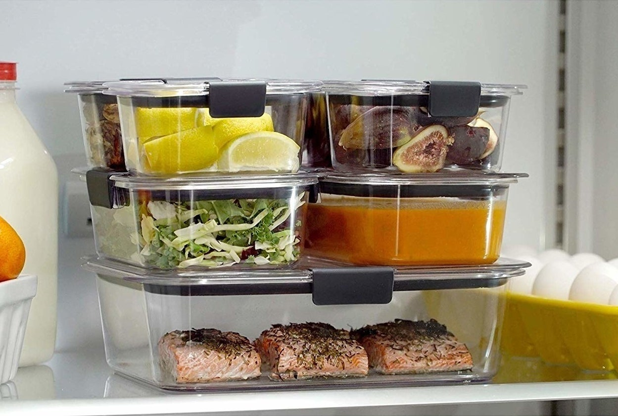 stack of three sizes of of completely clear containers full of food in a fridge; their lids seem to snap on