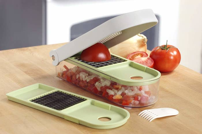 """Promising review: """"I love my vidalia chopper! It works great! I am really lazy when it comes to chopping up veggies and such, I really don't like doing it because it takes a lot of time, but the Vidalia Chop Wizard makes it go so much faster and smoother. I don't know what I would do without it."""" —RebeccaGet it from Amazon for $19.40."""