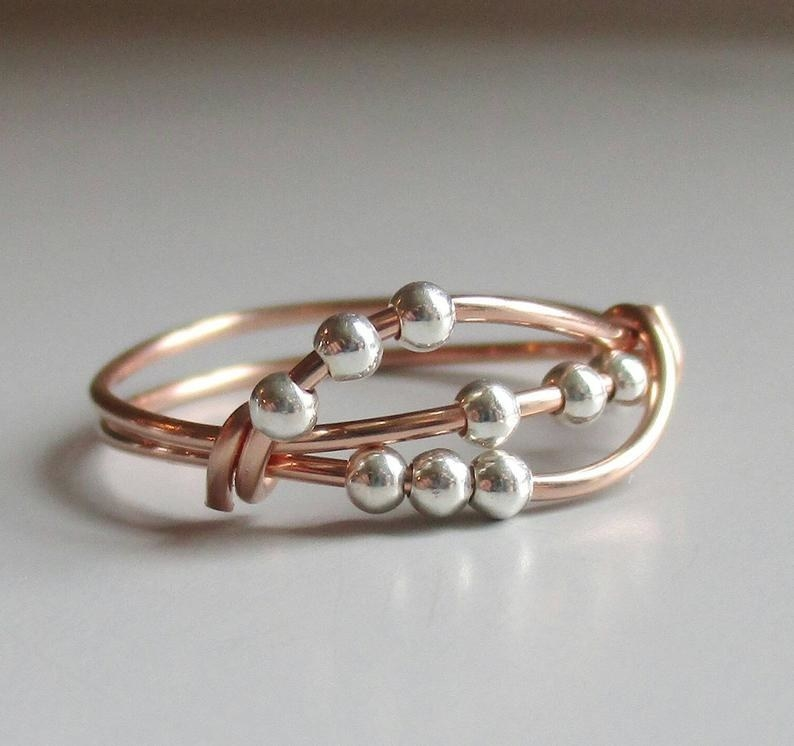 Three strands of copper wire with three silver beads for fidgeting with on each strand