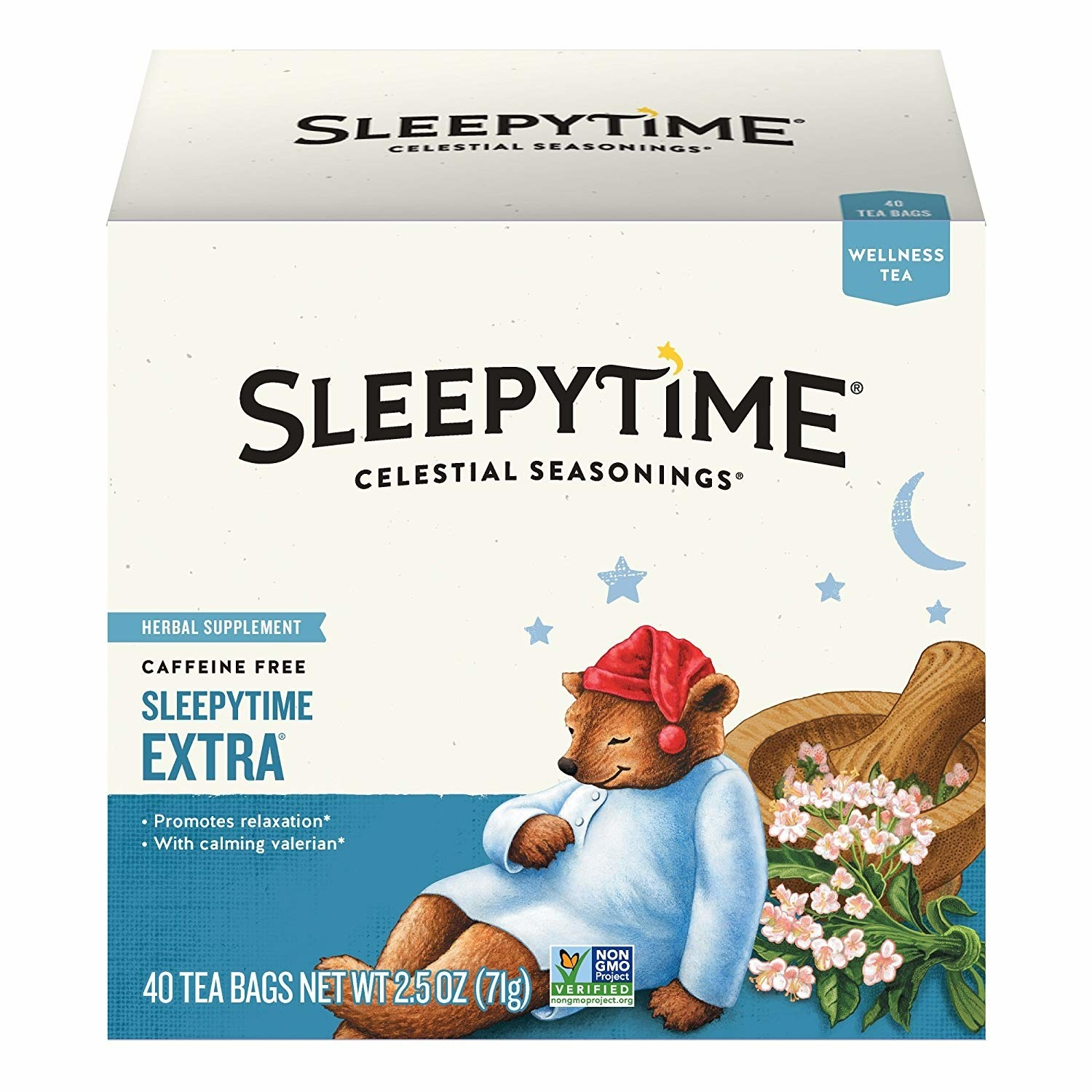 a box of the tea with a sleeping bear on it in pajamas