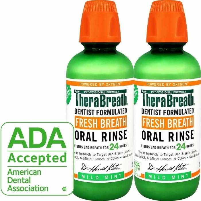 two green bottles of the oral rinse