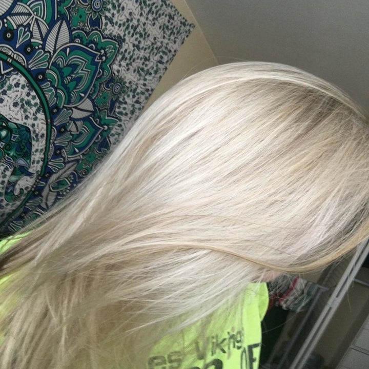 A customer review photo showing their hair after using the shampoo