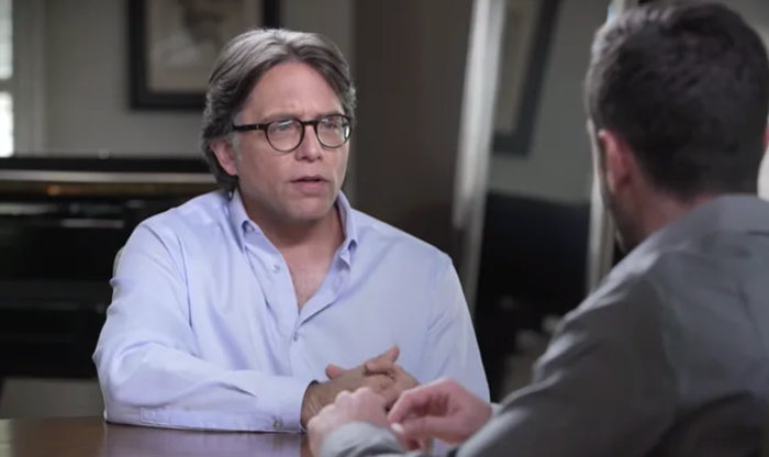 """Keith Raniere appears in a video for his """"Conversations"""" production."""