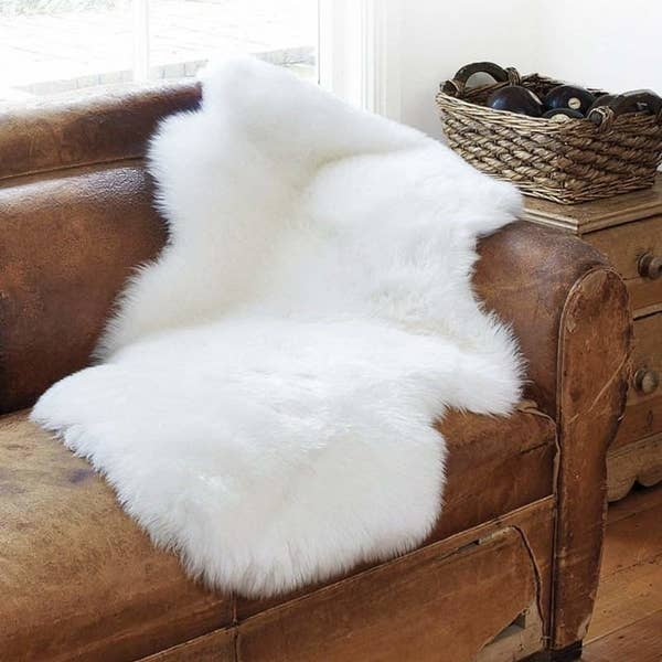 White faux sheepskin rug on a couch