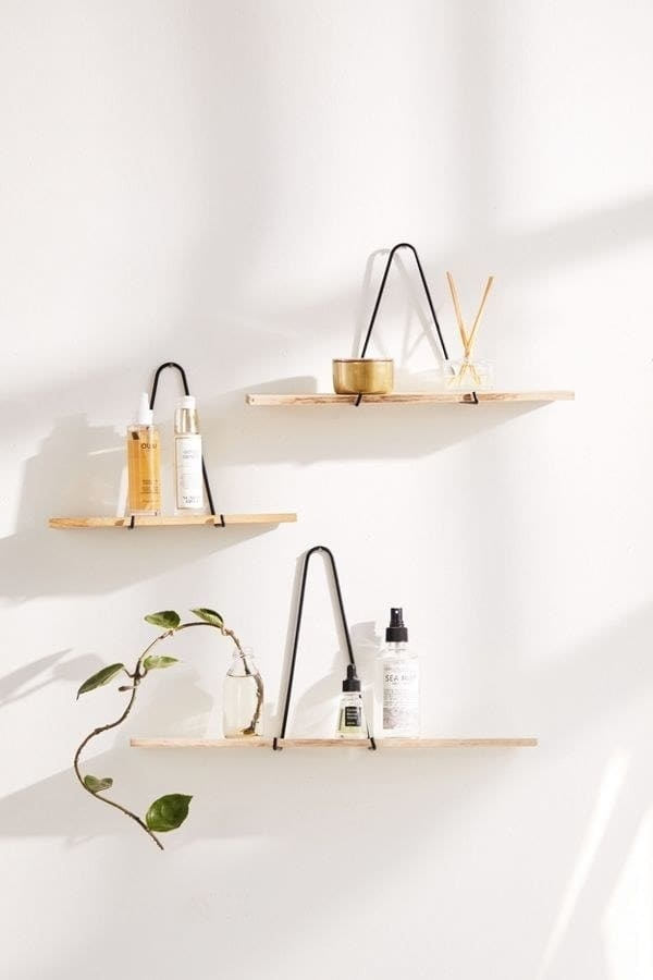 Triangle bracket wall shelves in three sizes hanging on the wall