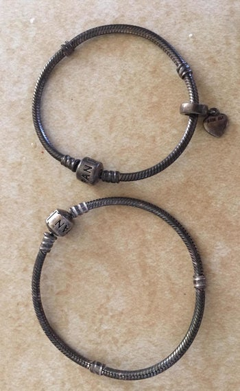 A reviewer photo of bracelets that are dark with tarnish