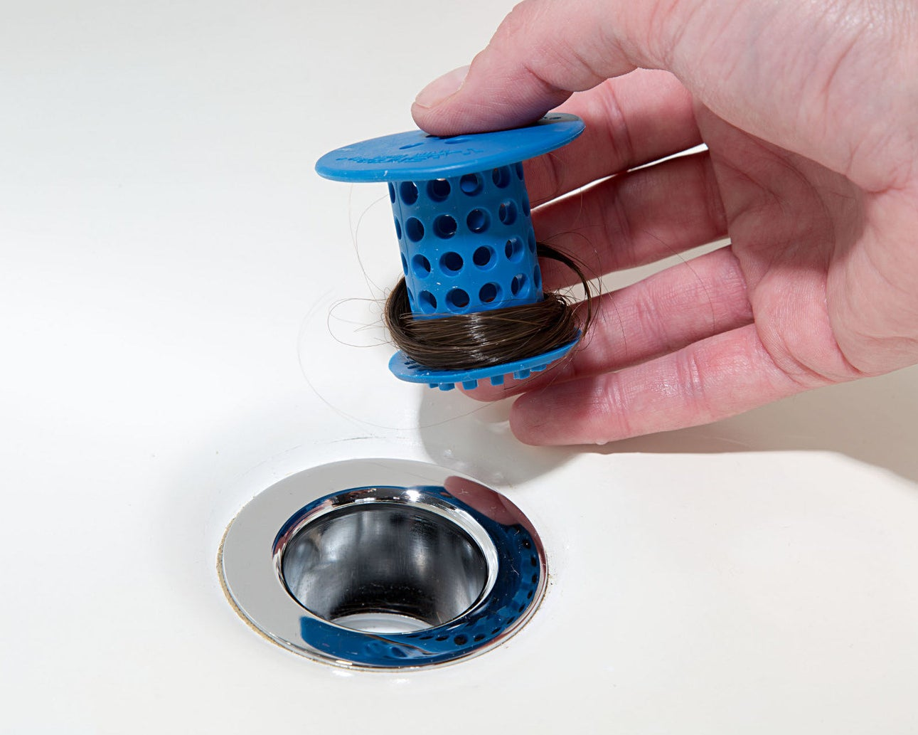 """I recently bought one of these and I can't believe I've waited all these years! I used to have a traditional strainer that would block the water flow as soon as a few hairs got caught in it (and I would have to fish out a clump of hair every five minutes or so). No more! This gadget catches all the hairs (so you don't end up with a clogged drain) and still allows the water to go down. I literally cannot stop talking about it.Promising review: """"I was skeptical about this little rubber strainer, but I needed something to save my drains from the piles of hair that fall out of my head. This thing is amazing! It fit into my standard drain perfectly, and I don't think a single hair slipped by it. It was pretty gross to see how much hair I lost in just one shower, but it was comforting to know it wasn't clogging my drain. Clean up is super easy, too. I just took a tissue and wiped it from top to bottom, grabbing all the hair as the soft rubber strainer released it all easily. Not a hair was caught in it. Best strainer I've ever had."""" —Lawyer For JusticeGet it from Amazon for $12.99 (available in six colors). Also, check out the SinkShroom and the ShowerShroom."""