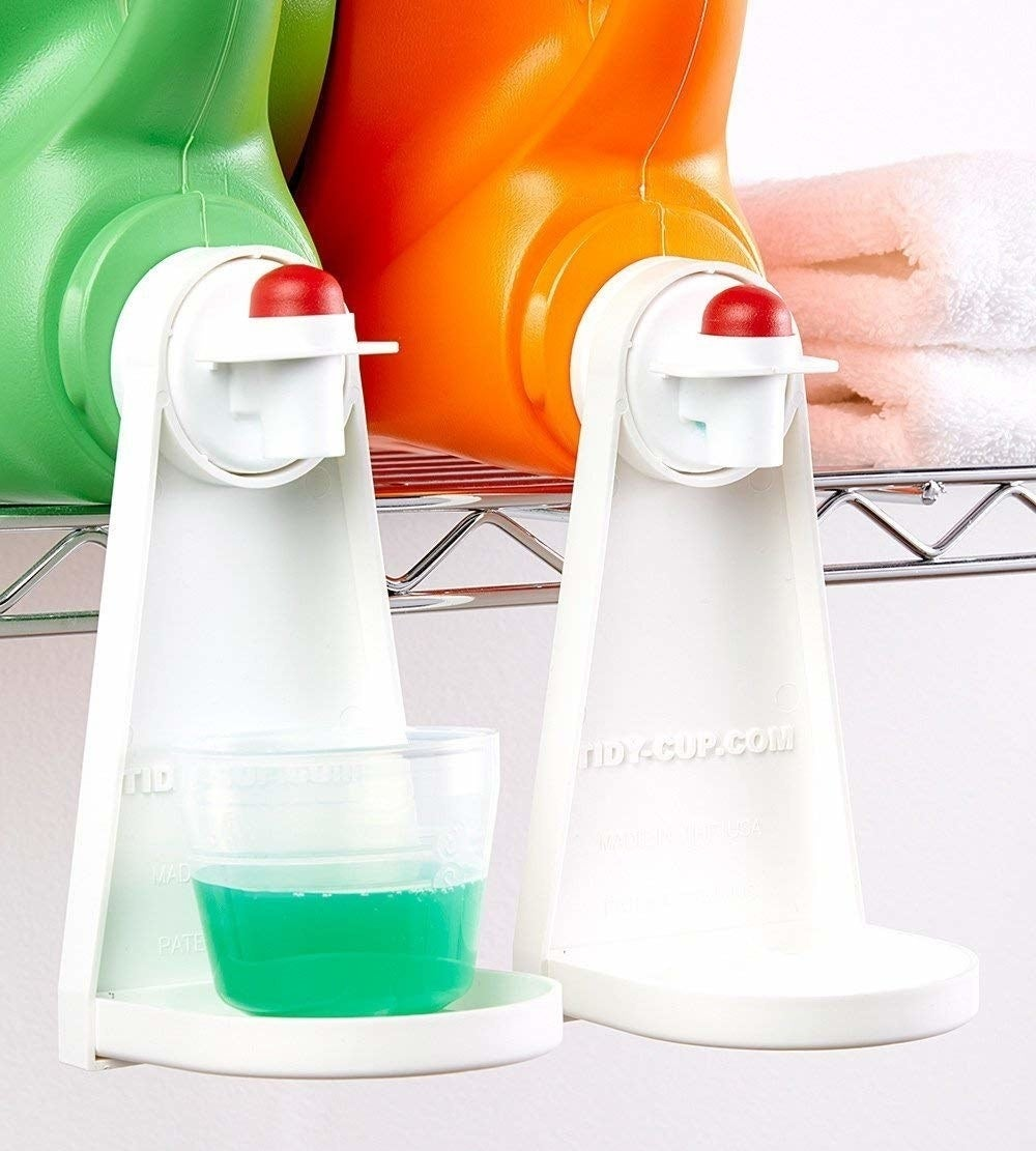 an attachment that hooks onto the spout of the detergent