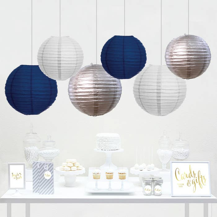 """The set comes with six white, navy, and silver lanterns, as well as a """"cards and gifts"""" sign. Price: $9.99"""