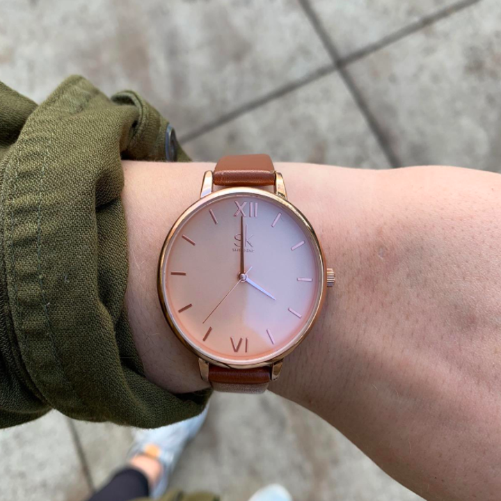 A different reviewer wearing the watch but in rose gold with brown straps