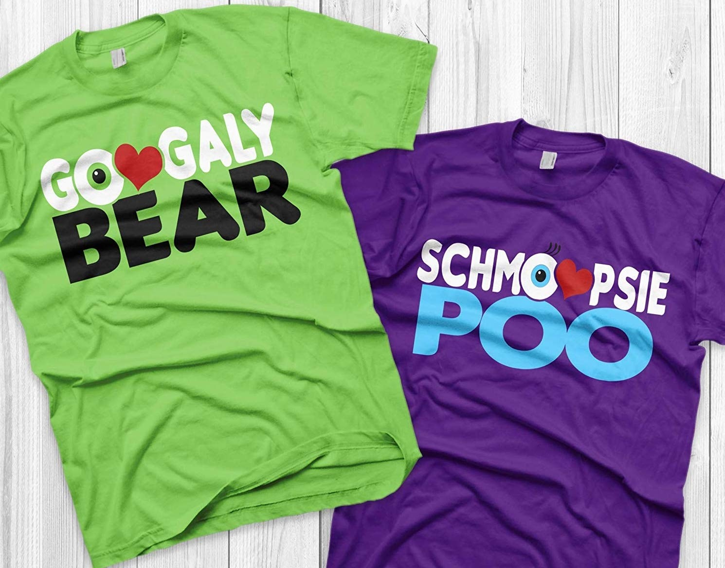 "to the left is a green T-shirt that says ""googaly bear"" with the second O as a heart, to the right is a purple T-shirt that says ""schmoopsie poo"" with the second O as a heart"