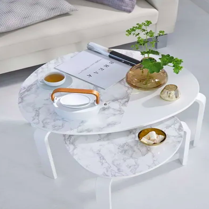 A set of two coffee tables with marble adhesive on the top adding to the look