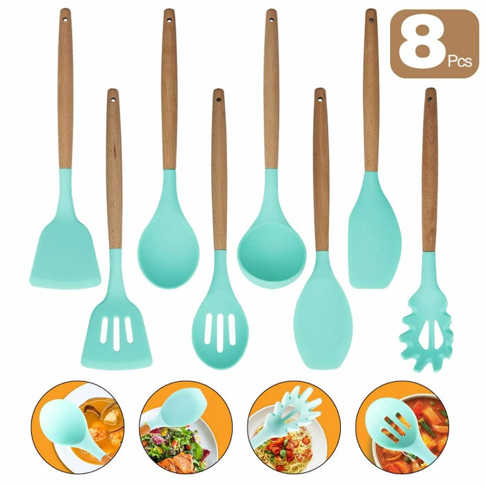 """In total you'll receive a spatula, round spatula, soup ladle, slotted spoon, solid spoon, spaghetti server, slotted turner, and a wide slotted turner.Promising review: """"If you are looking for kitchenware that will not scratch your pots, this set is the right thing to buy. The wooden handles are study, but at the same time, the silicone part is soft. It seems to be durable, as well. Also, it can be cleaned in no time. Overall a great set!"""" —SajanGet the set from Amazon for $23.99+ (available in three colors)."""