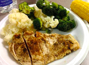 A reviewer's plate of their steamed fish and veggies