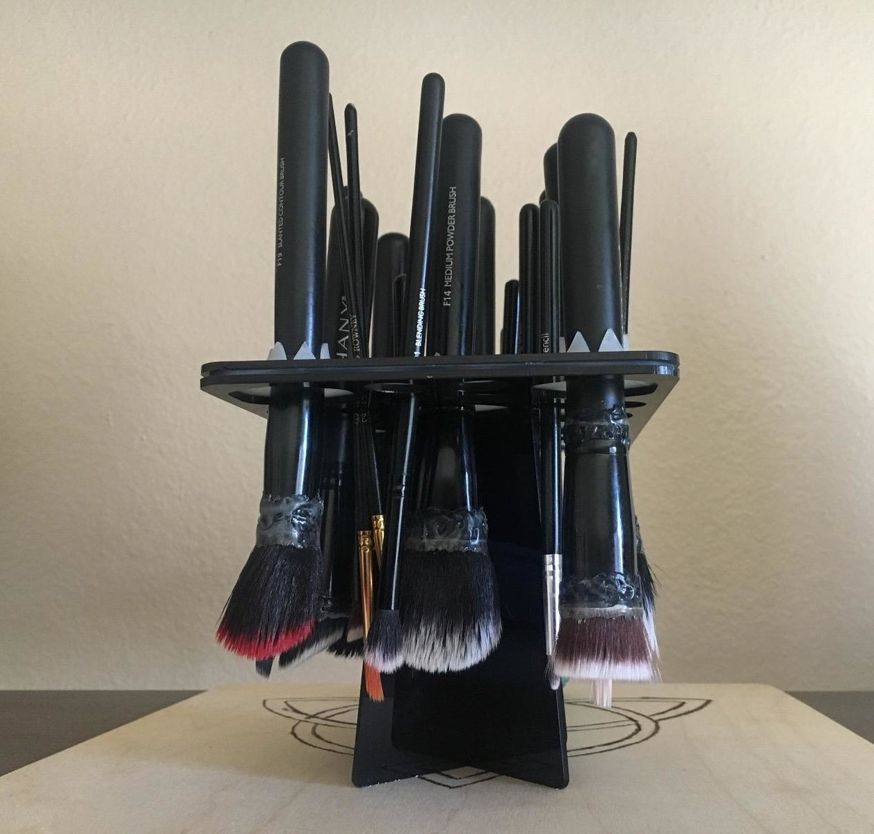 Reviewer image of makeup brushes drying upside down on the tree