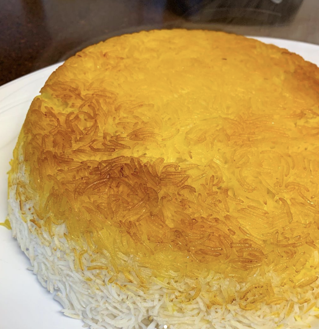 """Tahdig (tad-eek). It is an Iranian dish that literally means ""bottom of the pan."" It is essentially a large circle of crunchy and fried basmati rice. It is heaven for rice lovers.""—kiran2345rry"