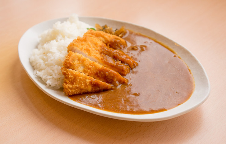 """A deep-fried cutlet of pork, on a bed of rice with thick curry sauce poured over the top.""—lobster_conspiracy"