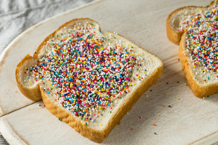 """The most beautiful invention to have ever come out of Australia in my humble opinion. For those of you who have the misfortune of not knowing what fairy bread is, it's a slice of white bread spread with a thin layer of butter and then sprinkled with a generous layer of 100s and 1000s. Heavenly.""—yusrak"
