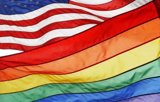 The pride flag flies beneath the American flag at the Stonewall National Monument in New York City.