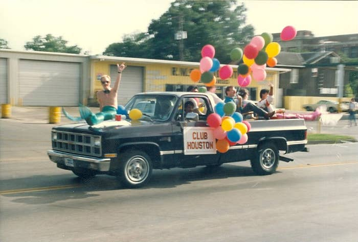 Men riding in a pickup truck during the Houston Pride Parade in 1986.