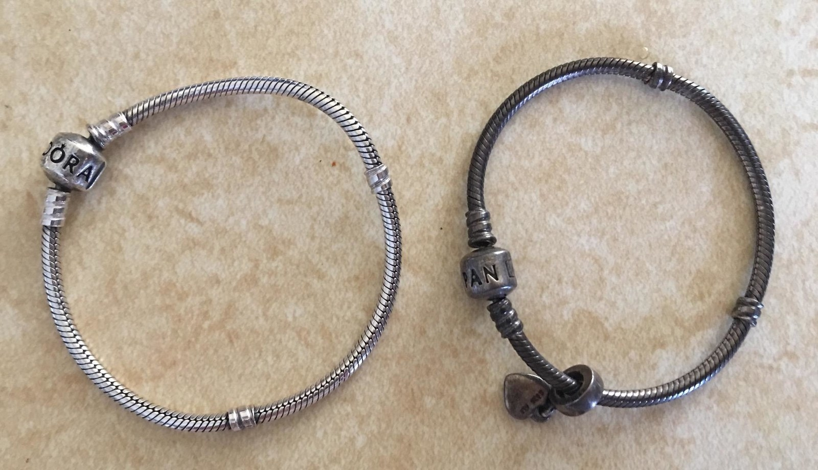 right: reviewer's bracelet looking tarnished and dark grey left: reviewer's bracelet looking shiny and silver
