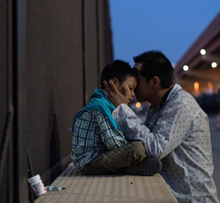 José, 27, embraces his son, José Daniel, 6, after crossing the border into the US on May 16, in El Paso, Texas.