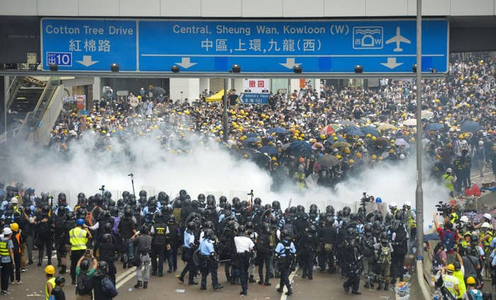 Protesters clash with riot police near Hong Kong's Legislative Council building.