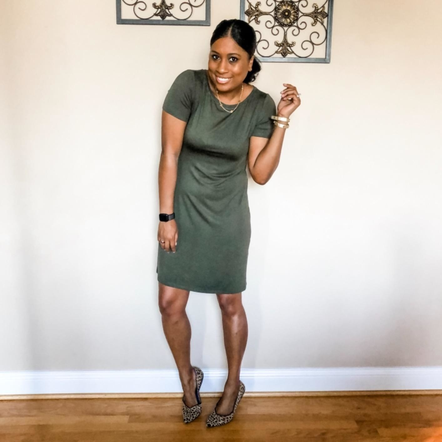 Reviewer wearing the dress in green