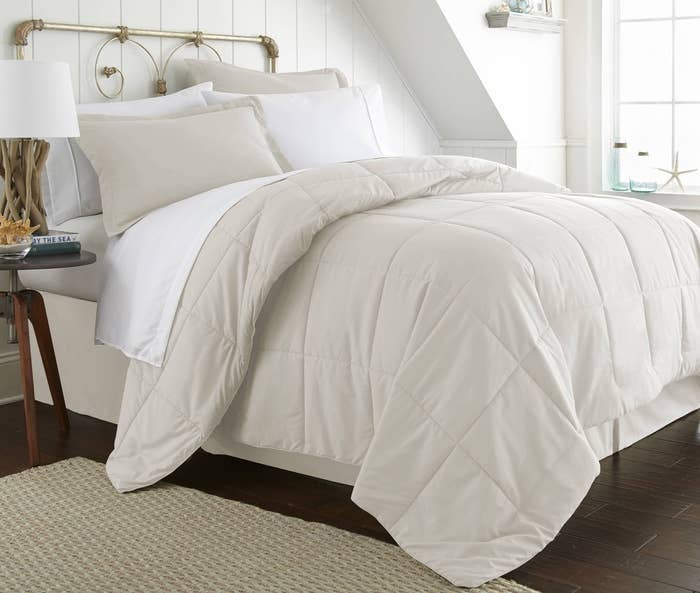 "This set comes with a comforter, a fitted sheet, a flat sheet, a bed skirt, two pillow shams, and two pillowcases!Promising review: ""This set is amazing. Comforter is soft and lightweight. Comes with sheets and a bed skirt. Sheets are extremely soft. I am so amazed by the quality of this product for the price!"" —EmilyPrice: $35.49+ (available in 11 colors, and six sizes)"
