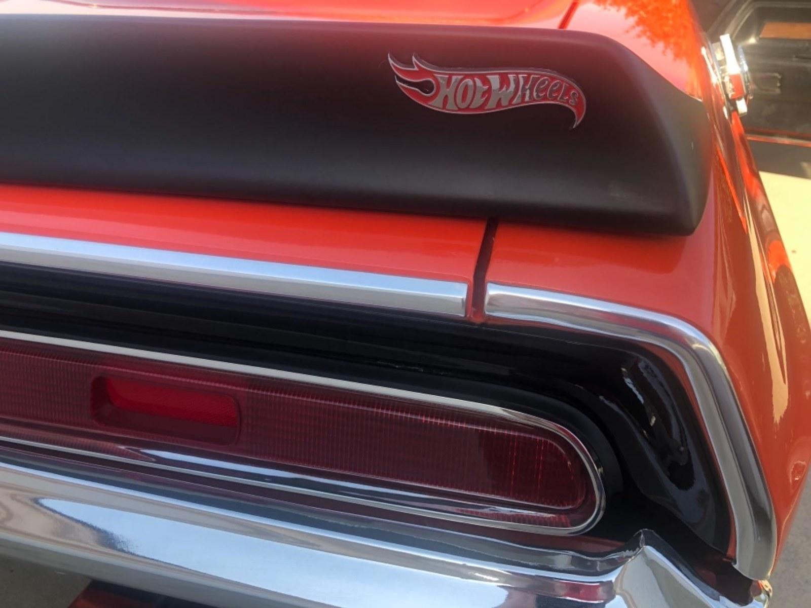 hot wheels logo on car