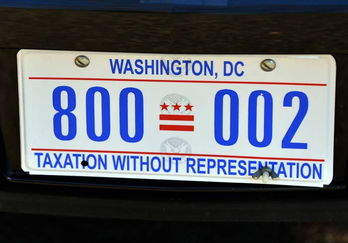 """Former president Barack Obama's limo with DC's """"Taxation Without Representation"""" license plate."""