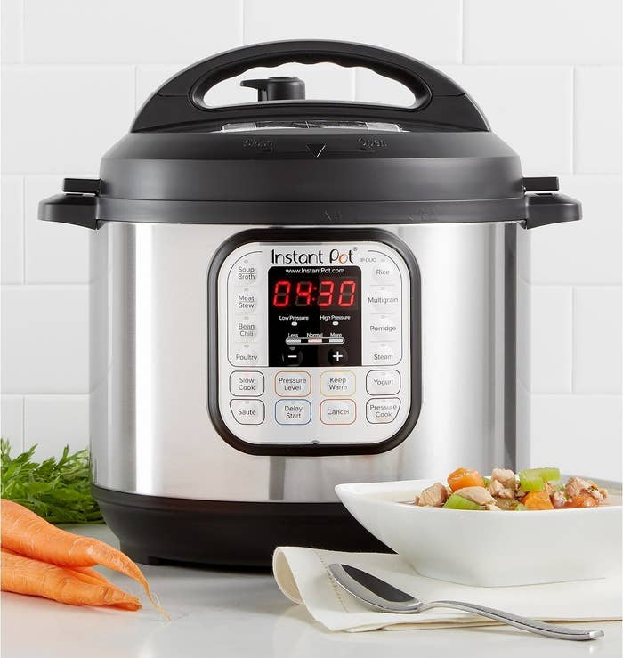 The instant pot, featuring preset buttons and a digital display
