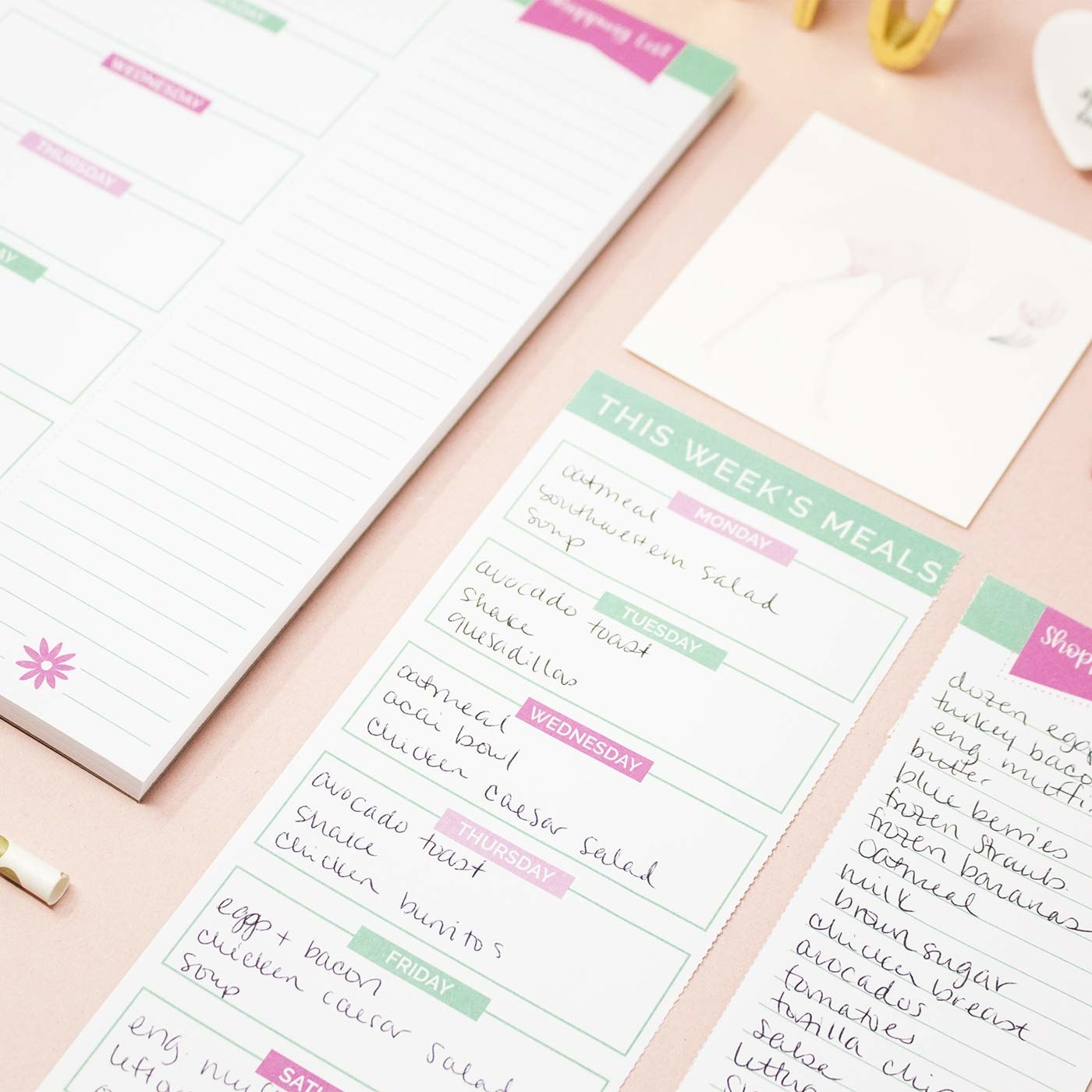 The floral-themed pad, featuring planning area for each day of the week as well as a shopping list