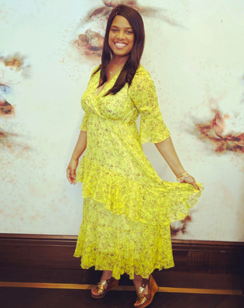 A reviewer wearing the 3/4-sleeve dress in yellow